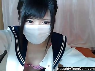 Japanese schoolgirl stripping on cam