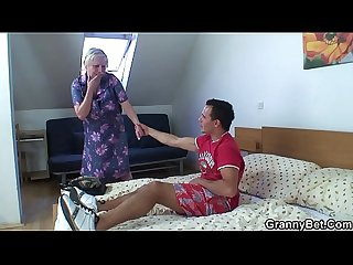 Young dude doggy-fucks horny old blonde grandma