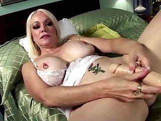 Blonde horny grandma in teasing solo