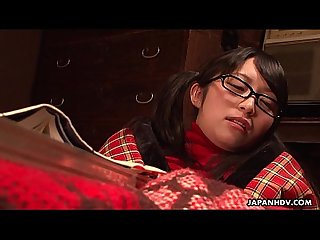 Nerdy asian teen rubs her cunt under the blanket