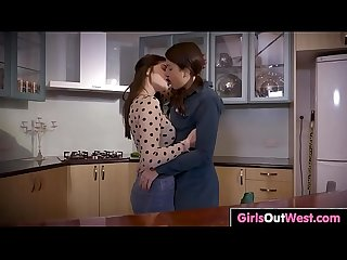 Hot brunette lesbians lick cunts in the kitchen