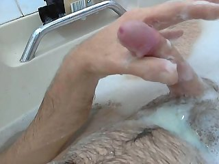Mature guy cumming in the bathtub
