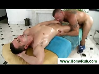 Muscular gay masseuse gives bj
