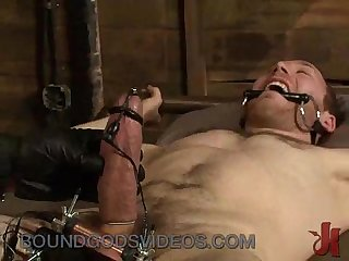 Bound gay punished by muscle master