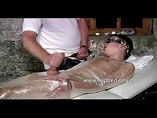 Twink wraped in clear film gets stroked