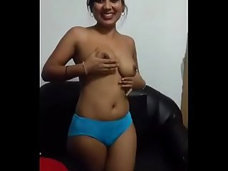 Desi call girl removing her red bra