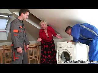 Naughty granny pleases two repairmen