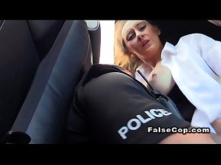 Tattooed babe fucks in police car in public