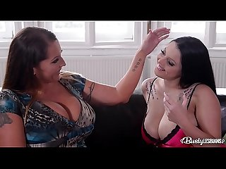 Busty lesbians Laura Orsolya & Themis Thunder have fun with strap-on dildo