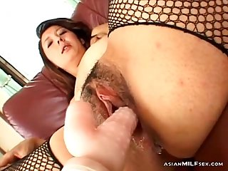 Milf in fishnet stockings getting her pussy stimulated and fucked with toys by 2