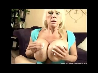 Huge titted granny gives a titfuck
