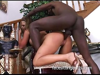 Busty blonde slut slobbers a black knob