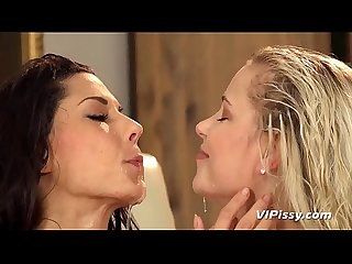 Pissing Lesbians - Playful girls dive into their piss puddle