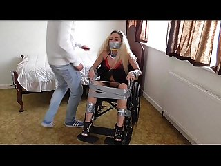 a bitch is taped to her wheelchair for being argumentative