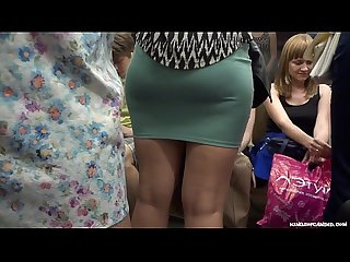 Candid lovely round milf ass in miniskirt