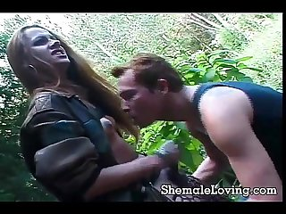 Wild shemale sucking a cock outside