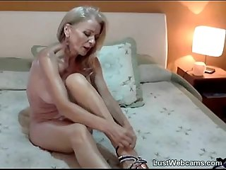Blonde milf toys her ass on webcam