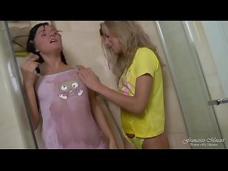 Two lesbian teens have a real orgasm with anal dildo in the shower