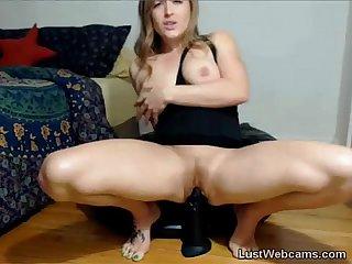 Blonde babe rides big black dildo on webcam