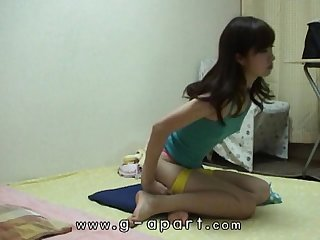 Peeping Japanese teen HARUKA's short shorts exercise in her apartment