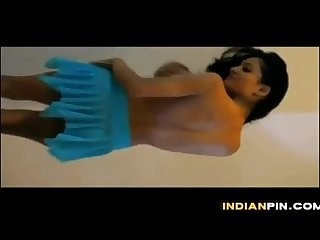 Indian babe doing a striptease at home