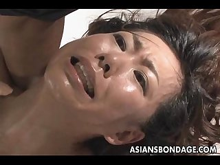 Japanese fucked by a big dildo bondage