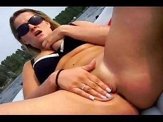 Amateur blonde masturbating on boat