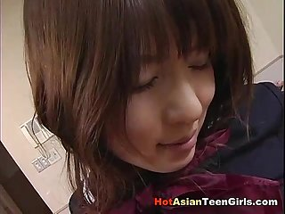 Asian schoolgirl rubbing her hairy pussy