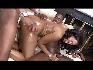 Horny ebony slut needs two black cocks in her fuckholes on the sofa