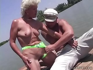 Granny effie fucks next to a lake