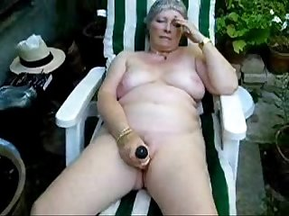 Pervert granny maturbating in court yard. Amateur older