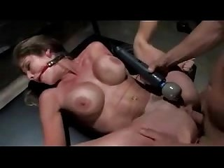 Busty girl with tied arms getting her pussy licked fucked sucking in the dungeon