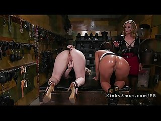Blonde lesbo gets many toys up her ass in dungeon