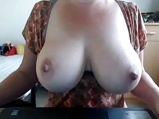 Milf grabbing her big boobs tease Webcams