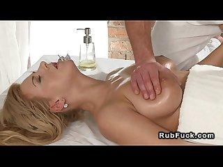 Masseur rubs busty blonde till gets her pussy