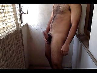 Horny indian guy masturbating outdoor in balcony