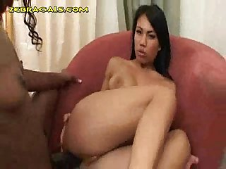 Ebony gal fucks with strap on asian girl