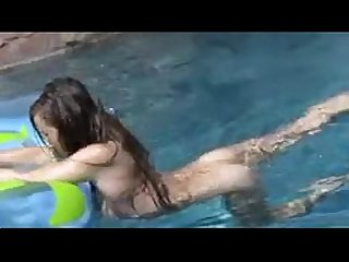 sexy teen masturbates outside in the swimming pool