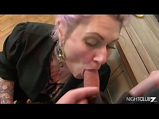 Tattooed stepmom fucks a younger guy