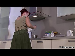 Mom and girl lesbian action on the kitchen