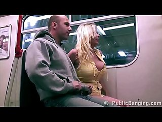 A girl with big tits is fucked by 2 guys in a public subway train