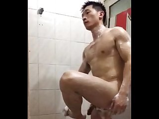 Handsome chinese police take a bath