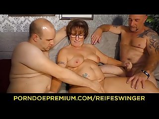 Reife swinger chubby german Granny sucks and fucks two cocks in naughty Threesome