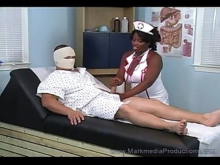 Black nurse milking white cock