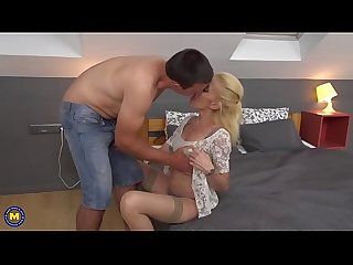 Blonde mature lady having fun with a young guy