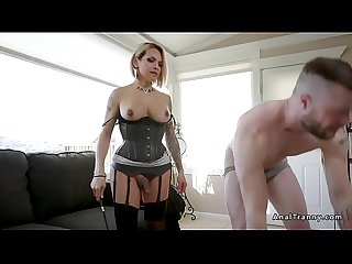 Tranny in fetish lingerie dominates guy