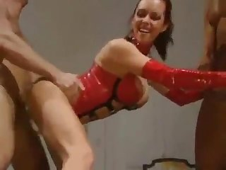 Busty Angelica Sin is so sexy in red latex girdle