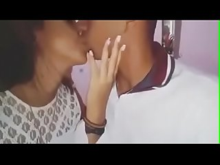 Indian boy kissing his girlfriend