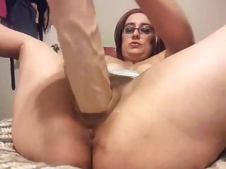 Party Milf fucks huge dildo while giving sloppy Blowjob and facial