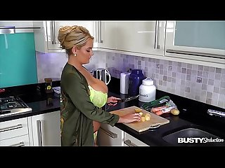 Busty seduction katie t fills her shaved pussy with veggies in the kitchen